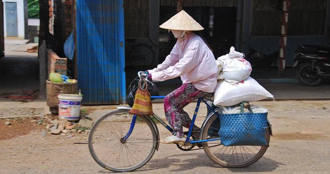 Women cycling through Saigon, Vietnam