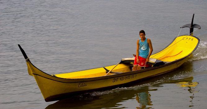 Traditional fishing boat off the coast, Atlantic Rainforest, Brazil