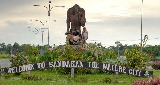 Orangutan statue and town sign, Sandakan, Sabah, Borneo