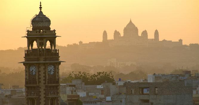 Clock tower and Umaid Bhawan palace in morning mist, Jodhpur, India