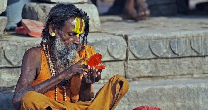 Religious man in robes, Varanasi, India
