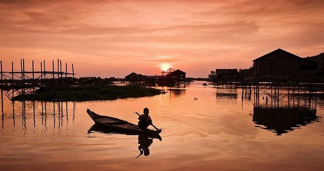 Fisherman at sunset on Tonle Sap Lake