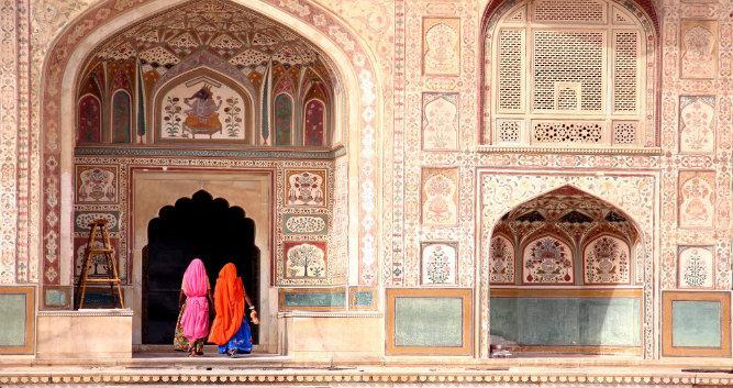 Two women walking through Amber Fort, Jaipur, India