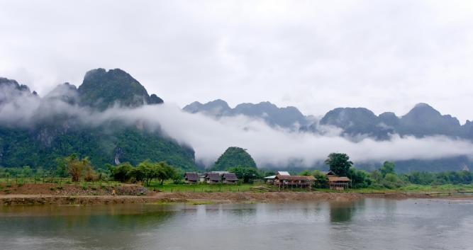 Local village on the riverbanks, Vang Vieng, Laos