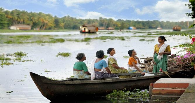 locals in a boat, kerala backwaters, India