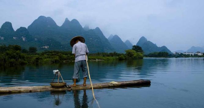 Image of Fisherman in Yangshuo, near Guilin, China - Luxury China Travel