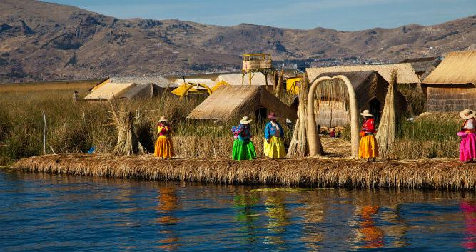Uros Villagers on a floating island, Titicaca Lake, Peru, South America